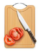 Tomato cuted segment with knife on hardboard — Stock Photo