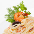 Spaghetti with seafood and cheese creamy sauce - Stock Photo