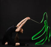 Beautiful gymnast with green ribbon — Stock Photo