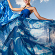 Beauty woman in blue dress on the desert — Stock Photo