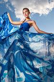 Beauty woman in blue dress on the desert — Stock Photo