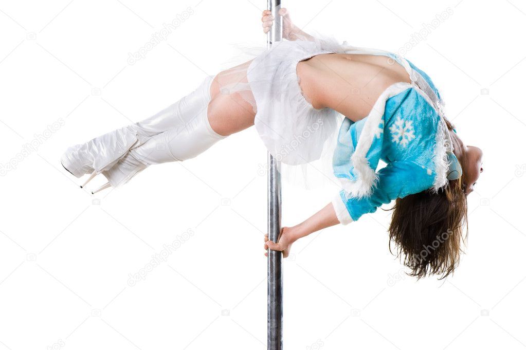 Young sexy woman in christmas dress exercise pole dance against a white background — Stock Photo #7673776