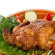 Fresh grilled whole chicken with vegetables — Stock Photo