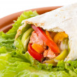 Burrito with salmon, peppers and tomato — Stock Photo