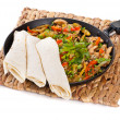 Traditional mexican beef fajitas with tortillas - Stock Photo