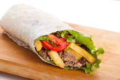 Beef burrito with peppers, fried potato and tomato — Stock Photo