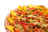 Spicy nachos with pork, tomato and pepper — Stock Photo