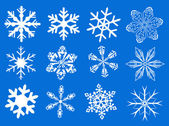 Snowflakes on blue background — Foto Stock