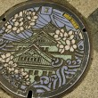 Manhole cover in Osaka, Japan — Stock Photo #7678501