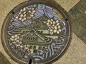Manhole cover in Osaka, Japan — Stock Photo