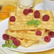 Waffles with honey — Stock Photo