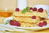 Waffles with raspberry — Stock Photo