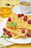 Waffles with raspberryes — Stock Photo