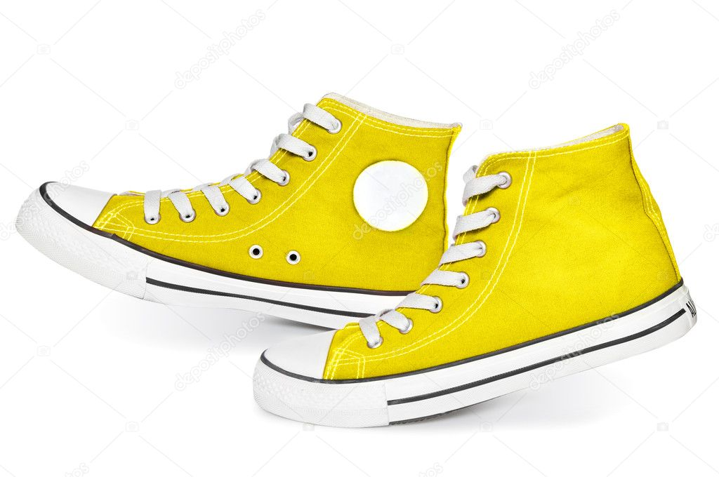 Pair of  new yellow sneakers isolated on white background — Stock Photo #7313810