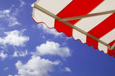Awning over bright sunny blue sky — Foto de Stock