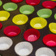 Vibrant cupcake wrappers (backing cups) in silicon/metal  tray — Stock Photo