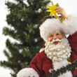 Santa with star — Stock Photo #7500320