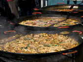 Paella in big pans — Stock Photo
