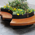 Modern wooden bench — Stock Photo