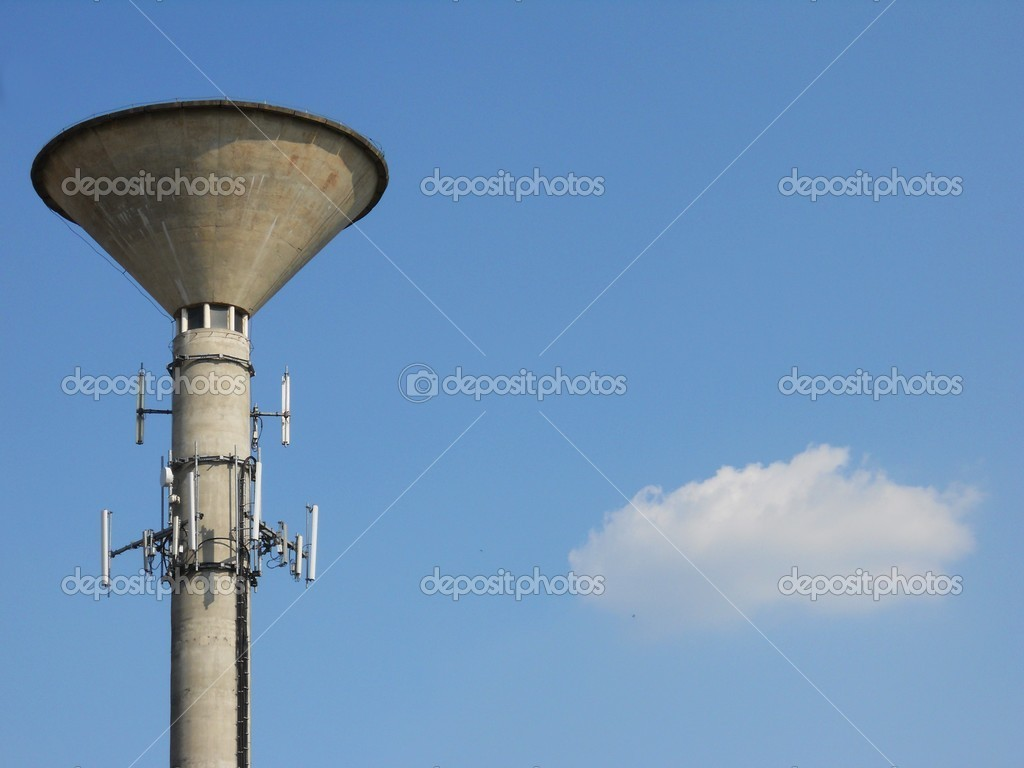 Concrete water tower on clear blue sky, horizontal view — Stock Photo #6850254