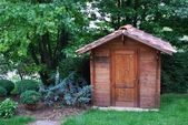 Wooden tool shed — Stock Photo