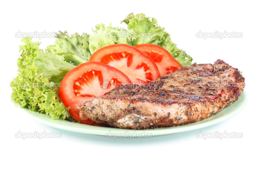Beefsteak with salad leaves and tomato segments on plate isolated on white background  Stock Photo #7157024