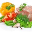 Piece of fresh raw meat with vegetables - Stock Photo
