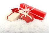 Christmas gift boxes on snow — Stock Photo