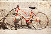Red Bicycle in Front of a Wall — Stock Photo