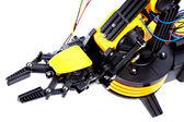 Closeup Black and Yellow Mechanical Robotic Arm — Stock Photo