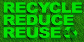 Recycle reuse and reduce word over green grass — Stock Photo