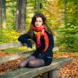 Young woman in autumn park — Stock Photo #6838971