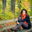 Young woman in autumn park — Stock Photo #6839044