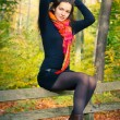 Young woman in autumn park — Stock Photo #6839133