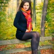 Young woman in autumn park — Stock Photo #6839182