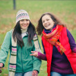 Two young womwalking in autumn park — Stock Photo #6891142