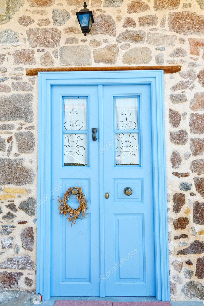 Blue door to the greek house — Stock Photo #7078525