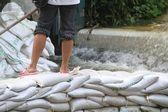 Flooding and sandbags in a Bangkok street. — Stock Photo