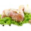 Raw chicken legs with green salad and garlic — Stock Photo