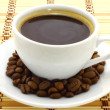 Coffee cup with coffee beans — Stock Photo #6964647