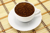 Cup of ground coffee — Stock Photo
