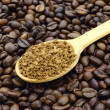 Ground coffee in wooden spoon — Stock Photo