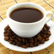 Coffee cup with beans — Stock Photo #7027745