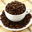 Coffee cup with coffee beans — Stock Photo #7027749