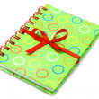Notepad with red bow — Stock Photo