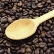 Coffee beans with wooden spoon — Stockfoto