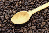 Coffee beans with wooden spoon — Stock Photo