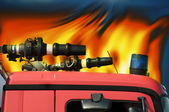 Fire truck and flames — Stock Photo
