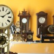 Old antique clocks — Stock Photo