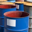 Old colored barrels for oil products — Stock Photo